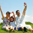 Family waving hands — Stockfoto