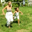 Daughter running with her mother — Stock Photo