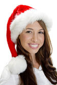 Female model smiling wearing christmas hat — Stock Photo