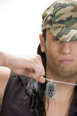 Young male pulling his chain — Stock Photo