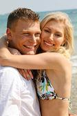 Carefree couple on the beach — Stock Photo