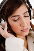 Portrait of woman tuned in music — Stock Photo