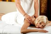 Woman enjoying massage — Zdjęcie stockowe
