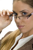 Pretty woman posing with her eyewear — Stock Photo