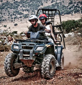 Young couple riding sand buggy — Stock Photo