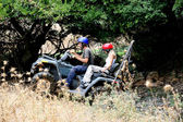 ATV climbing, couples enjoying ride — Stock Photo