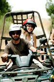 Young man drives the quad with his woman — Stock Photo