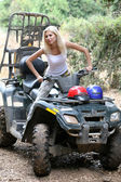 Pretty young lady posing on quadbike — Стоковое фото