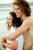 Adorable couple embracing at beach — Stock Photo