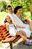Jolly family resting in shade — Stock Photo