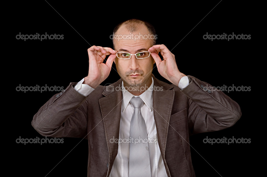 Aged male putting up glasses against black background — Stock Photo #1365342