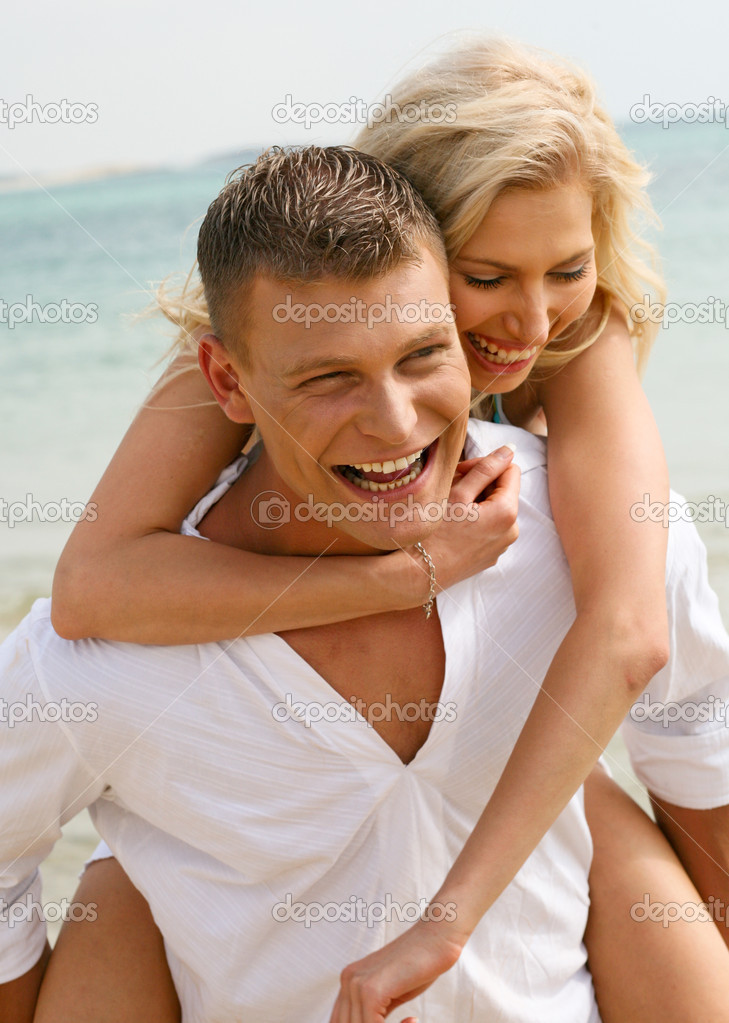 Happy young couple having fun on the beach — Stock Photo #1365477