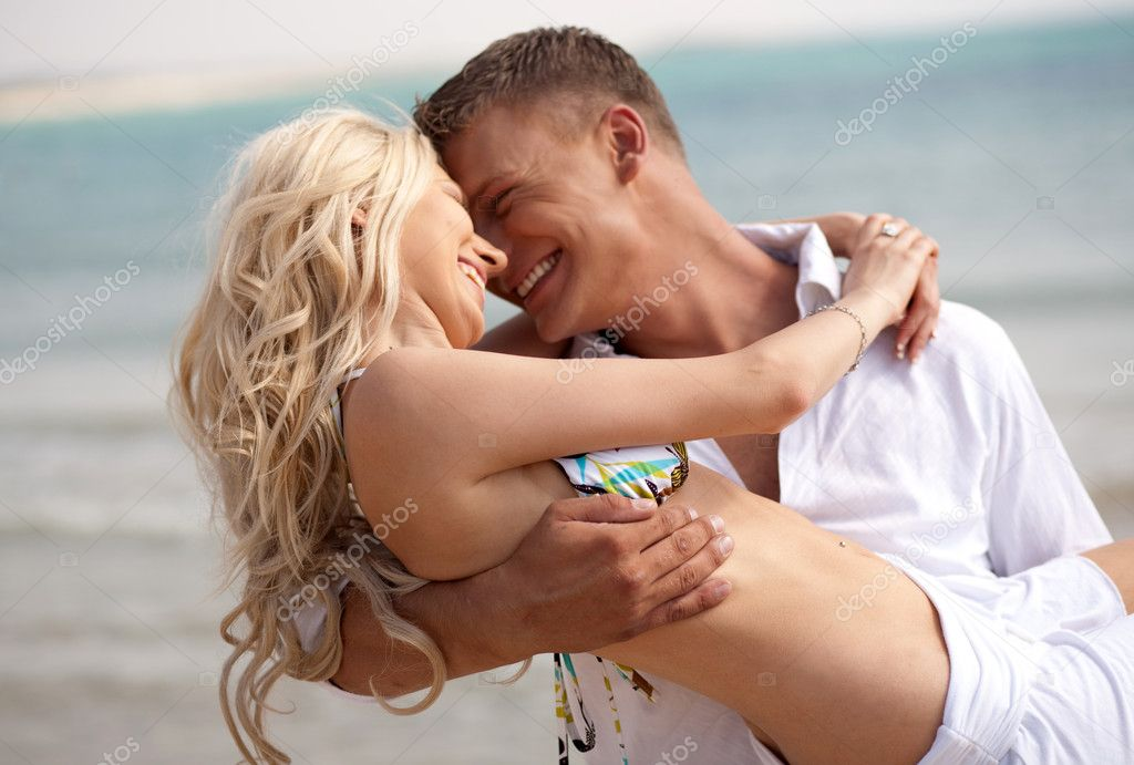 Playful couple making love on the beach  Stock Photo #1365754