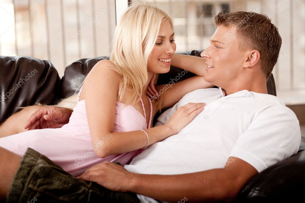 Hot young couple on couch  Stock Photo #1366104