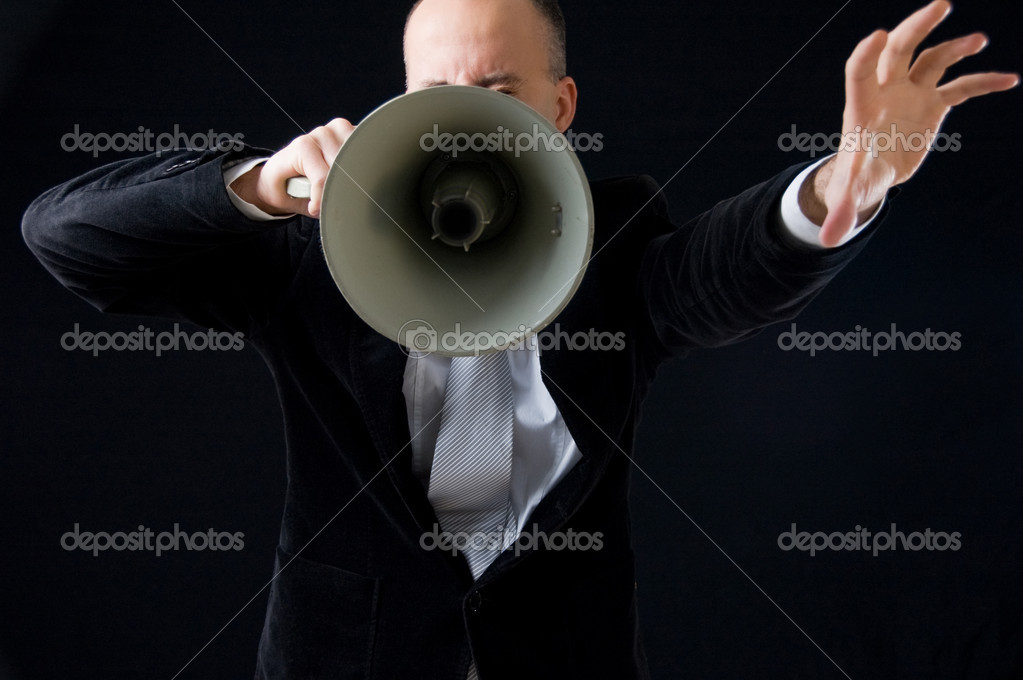 Businessman making announcement through megaphone — Stock Photo #1366576