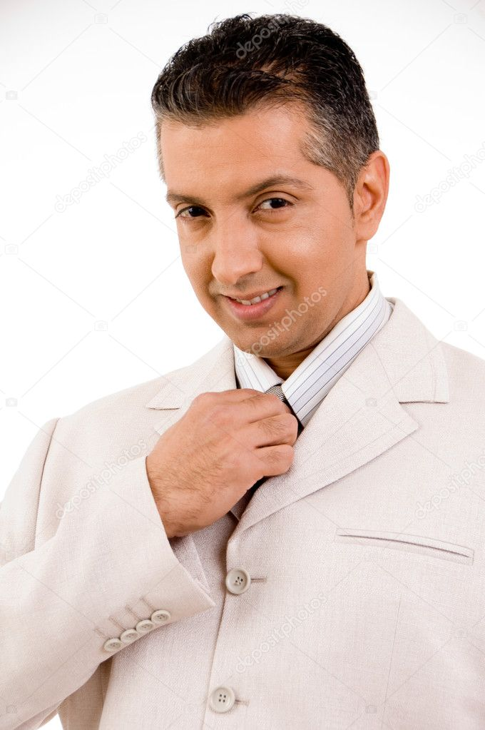Senior manager adjusting tie and smiling against white background — Stock Photo #1366819