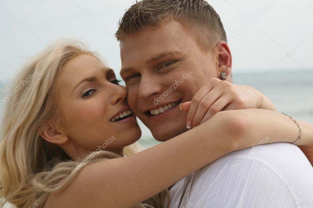 Loving couple at the beach — Stock Photo #1368143
