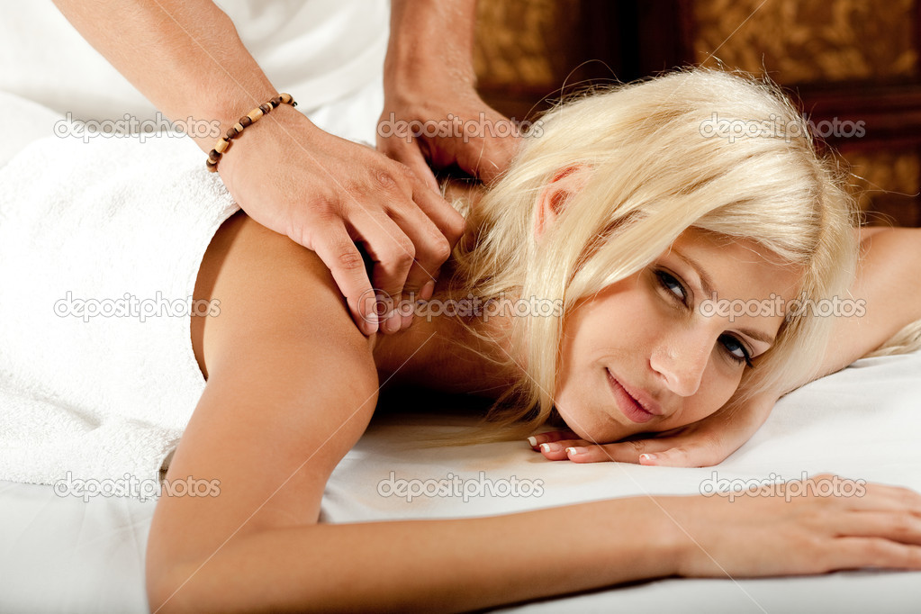 Massage at the day spa as woman looks into the camera  Stock Photo #1368355