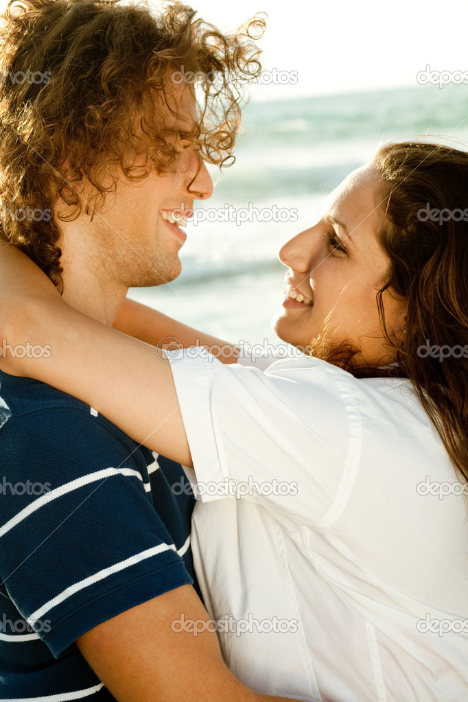 Man and woman enjoying together at the beach  Stock Photo #1369109