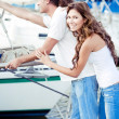 Couple at harbor waiting - Stock Photo