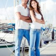 Cheerful young couple posing - Stock Photo