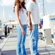 Young couple posing on boardwalk — Stock Photo