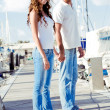 Young couple posing on boardwalk — Stock Photo #1370175