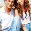 Young couple posing in front of camera - Stock Photo