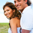 Young man embracing female from back — Stock Photo #1370208