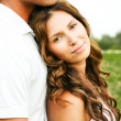 Young woman leaning on her man - Stock Photo