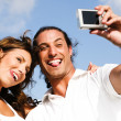 Funny smiling couple caught in camera — Stock Photo #1370345