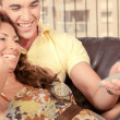 Man and woman enjoying tv — Stockfoto