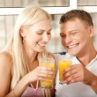 Couple enjoying orange juice — Foto de Stock   #1370708