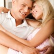 Sexy lady sitting on man's lap - Foto Stock