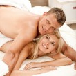 Sexy couple in bed smiling — Stock Photo