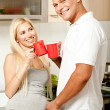 Couple enjoying coffee in kitchen — Stock Photo #1371046