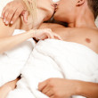 Guy and lady kissing in bed — Stock Photo #1371094