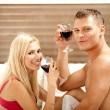Man and woman sharing drink — Stock Photo