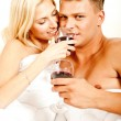 Stock Photo: Drink at erotic honeymoon