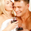 Stock Photo: Couple smiling and enjoying wine