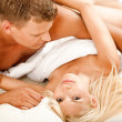 Mid adult couple making love - Stock Photo