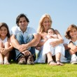 Portrait of happy family of five - Stock Photo