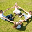 Foto Stock: Family enjoying together on grass
