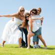 Family wearing sunglasses - Stock Photo
