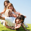 Portrait of happy family of four — Stock Photo #1371559