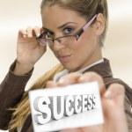 Businesswomen holding success card — Stock Photo