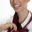 Young happy woman tying her tie — Stock Photo #1372232