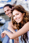 Lady and guy posing on footbridge — Stock Photo
