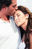 Young man kissing his girl — Stock Photo