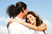 Guy carrying his girlfriend in arms — Stock Photo